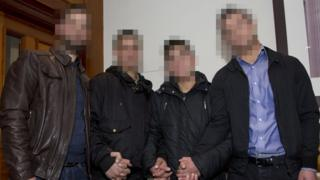 The four Syrian refugees with their faces pixelated