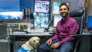 Dr Amit Patel with his guide dog Kika in a TfL recording studio