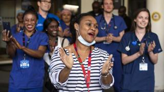 NHS staff take part in a weekly Clap for Carers during lockdown
