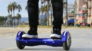 Michael Tran uses his hoverboard on the Venice Beach Boardwalk on 10 December 2015