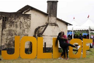 "Women hug beside letters reading ""Jollof"", a popular dish in Nigeria and across West Africa, during the Jollof rice festival in Lagos, on August 20, 2017"