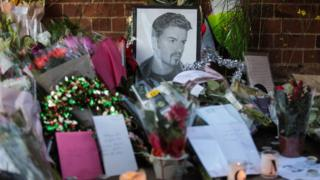 Flowers and tributes laid outside the Oxfordshire home of George Michael