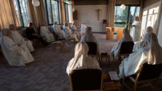 Nuns at a Good Friday service in the Benedictine convent at Rixensart in Belgium