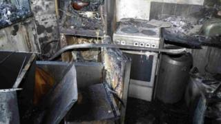 The burnt out kitchen where the Grenfell Tower fire started
