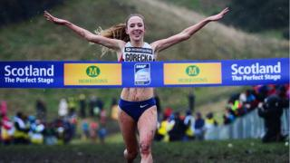 Emelia Gorecka of Great Britain celebrates winning the Senior Women's 6K race during the Great Edinburgh X Country at Holyrood Park on January 10, 2015