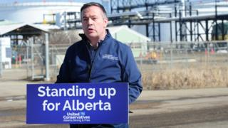 UPC leader Jason Kenney campaigns in front of the Trans Mountain pipeline Edmonton terminal