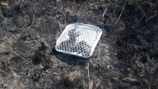 environment Disposable barbecue on burnt land