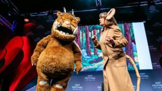 Julia Donaldson on stage with the Gruffalo