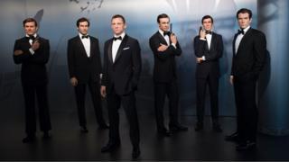 Wax figures of James Bond actors (L-R) Roger Moore, Timothy Dalton, Daniel Craig, Sean Connery, George Lazenby and Pierce Brosnan