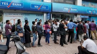 Queue of people outside a branch of Yes Bank