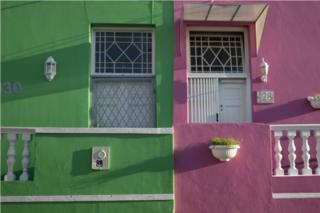 Two conjoined houses are pictured. One is mint green, the other a powdery pink.