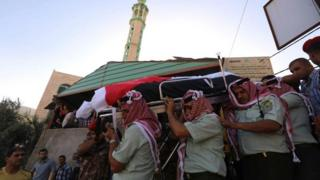 Jordanian soldiers carry coffin of comrade in Nahleh village after suicide bomb attack on border with Syria. 21 June 2016