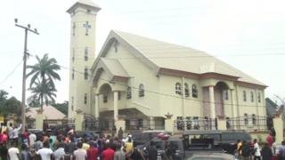 People gathered in front of the church attacked