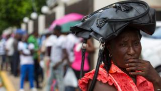 Haitian born immigrants who already subscribed to the Foreign Regularization Plan in Dominican Republic, wait to be attended at the Police and Interior Minister to receive their documents and complete the process, Santo Dominigo, Dominican Republic, on 22 June 2015.