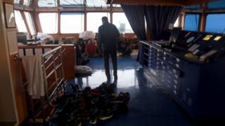 An Iranian official speaks to crew members on the Stena Impero