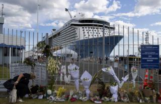 People leave tributes at the Port of Tauranga