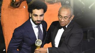 Mohammed Salah (left) dey collect award from CAF President Ahmad Ahmad (right)