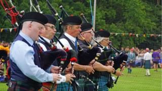 Massed pipe bands at Stonehaven Highland Games