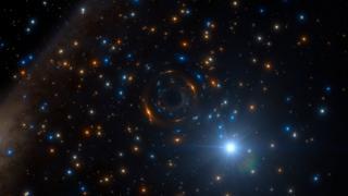 Impresión artística del sistema binario con el agujero negro
