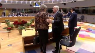 Theresa May speaking to Jean-Claude Juncker