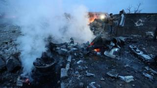 smoking wreckage of a downed Sukhoi-25 jet in Saraqeb