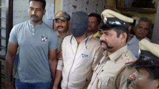 Dr Ameet Gaikwad with police