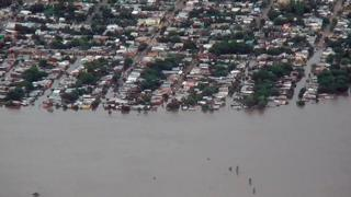 An aerial photograph shows flooding in Uruguay
