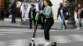 Woman riding an electric scooter in Paris