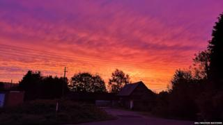 Red sky by a house