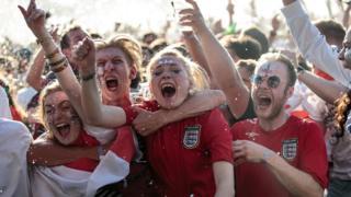 Fans celebrate Trippier's goal