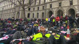 "Hundreds of cyclists taking part in the ""die-in"""