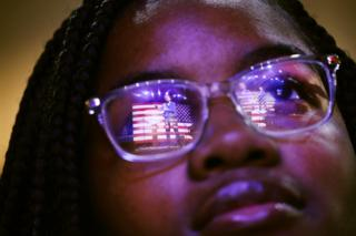 "Democratic presidential candidate Senator Elizabeth Warren is reflected in a student's glasses as she speaks at a ""Get Out the Vote"" Rally at South Carolina State University. 26 February 2020"