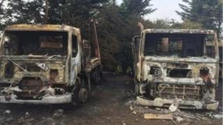 Damaged lorries after haulage yard fire