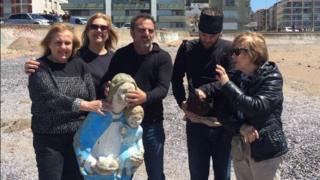 A picture tweeted by the Punta del Este authorities shows people holding up the statue which had been lost