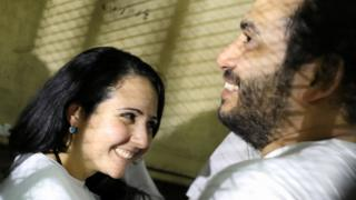 Aya Hijazi and her husband Mohamed Hassanein at a courthouse in Cairo, on 23 March 2017