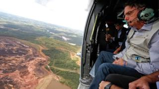 Brazilian President Jair Bolsonaro in a helicopter flying over a dam-affected area near Brumadinho, Minas Gerais, on January 26, 2019, entered into force on January 19, 2019.