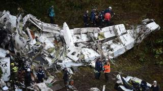 Rescuers search for survivors from the wreckage of the Lamia airlines charter plane carrying members of the Chapecoense football team that crashed in the mountains of Cerro Gordo