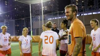 David Beckham with players from the University of Miami