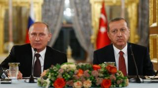 Russian President Putin talks during a joint news conference with his Turkish counterpart Erdogan
