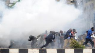 Kenya's opposition politicians and supporters run away from tear gas in Nairobi, Kenya - 9 May 2016