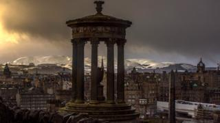 Calton Hill with snowy Pentland Hills in the background