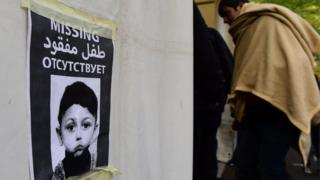 A poster features a portrait of four-year-old asylum-seeker Mohamed Januzi who went missing in Berlin (October 9, 2015)