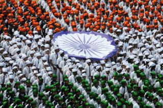 Indian school students form the national flag during an event to mark Republic Day in Chennai