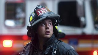 Firefighter looks up at the scene
