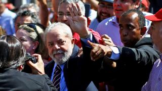 Former Brazilian President Luiz Inacio Lula da Silva arrives at the Federal Justice office to be questioned by anti-corruption judge Sergio Moro, in Curitiba