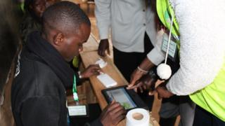 Person wey dem dey assist to cast e vote during di presidential election re-run for inside Kenya.