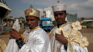 Ethiopian Orthodox deacon dey carry cross for Meskel Square wey dey Addis Ababa, Ethiopia as di Meskel Festival dey happen to take remember di discovery of di true cross wey dem use crucify Jesus Christ.