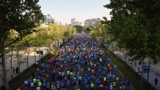 Participants in action during the 42nd Madrid Marathon in Madrid, Spain, 27 April 2019