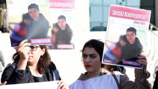 Women hold placards of Emine Bulut, who was killed by her husband, as they gather outside court in Kirikkale for the first hearing, 9 October 2019