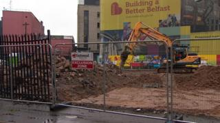 A digger working at the proposed site for the flats